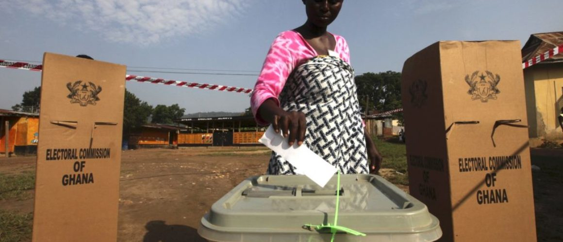 A woman votes at a polling station in Kibi